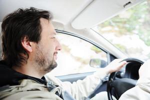Male driver in car