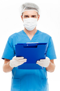 Male surgeon in mask holding clipboard isolated on a white background