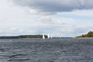 Mamry lake in Poland with sailboats photographed i early autumn. Yacht or boats on beautiful lake in Mazury lake district.