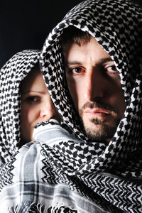 Man and woman with arabic palestinian colors