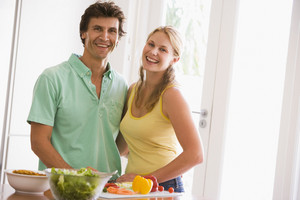 man and women preparing food