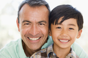 Man and young boy smiling