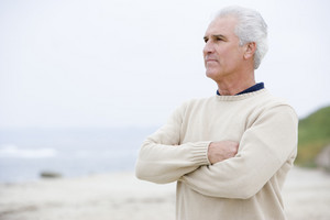 Man at the beach with arms crossed
