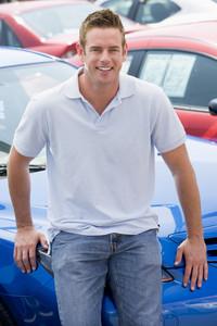 Man choosing new car on lot
