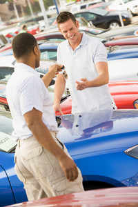 Man collecting new car from dealer