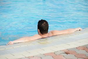 Man enjoying and relaxing on summer pool
