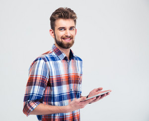 Man holding tablet computer and looking at camera