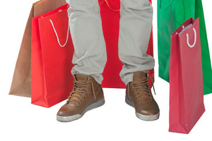 Man in boots surrounded by shopping bags