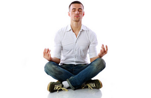 Man in casual cloth sitting in the lotus position over white background
