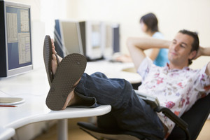 Man in computer room with feet up relaxing