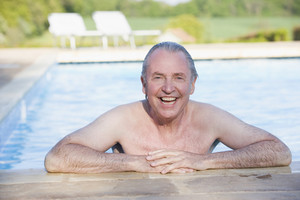 Man in outdoor pool smiling