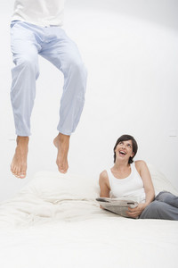 Man jumping on bed