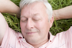 Man lying in grass sleeping