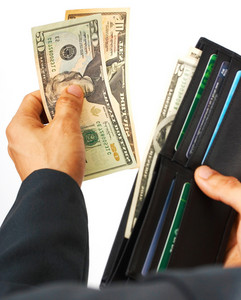 Man Paying A Bill In Dollars Cash