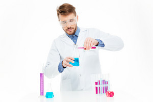 Man pouring chemicals isolated on a white background