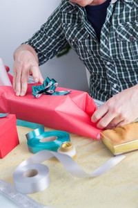 Man preparing gift