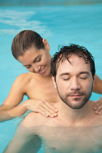 Man receibing a massage inside the pool