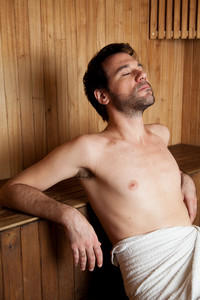 Man relaxed in the sauna