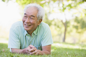Man relaxing outdoors smiling