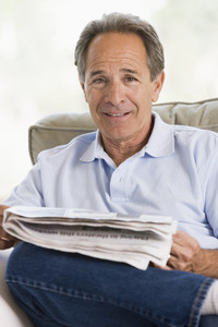 Man relaxing with a newspaper