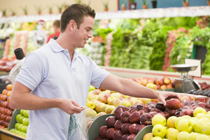 Man shopping in produce setion of supermarket