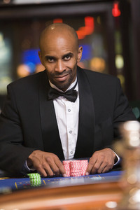 Man sitting at roulette table in casino