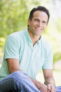 Man sitting outdoors smiling