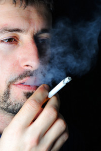 Man smoking in dark