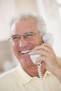 Man using telephone and smiling
