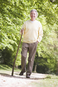 Man walking outdoors smiling