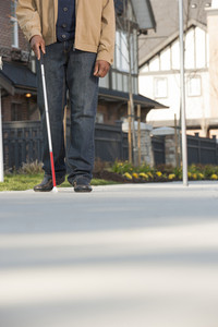Man walking with walking stick