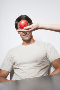 Man with apple inside