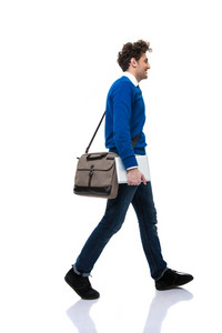 Man with bag walking over white background