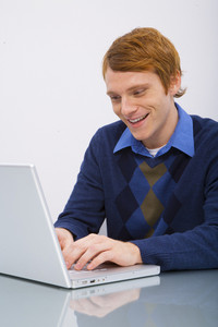 Man with laptop in office space