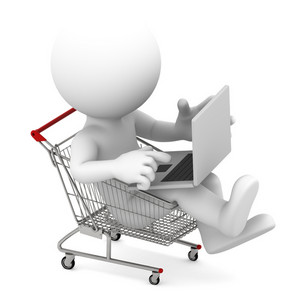 Man With Laptop Inside Shopping Cart. Online Shopping Concept.