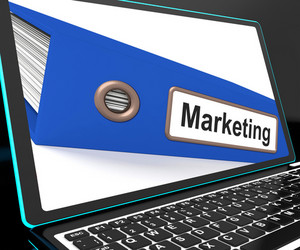 Marketing File On Laptop Shows Advertising Plans