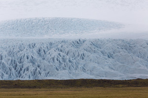 Massive glacier before flat farmland