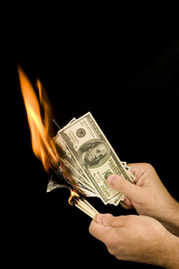 Match Setting Hundred Dollar Bills On Fire