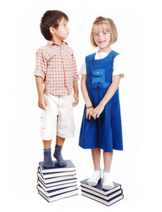 Measuring lenght on books, growning up, boy and girl
