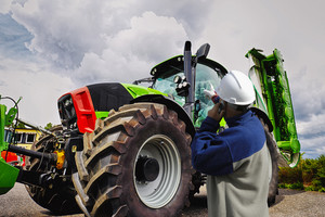 mechanic, farmer with large tractor, latest model