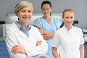 Medical team of three professional woman at dental surgery portrait