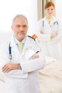 Medical team - portrait of two doctor with stethoscope in hospital