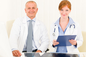 Medical team senior man with female doctor look at camera