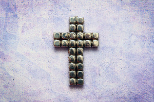 Metal Cross On Grunge Background