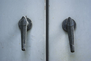 Metal handle on blue door