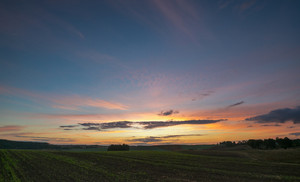 Beautiful after sunset sky over fields. Colorful landscape