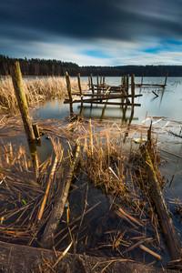 Small pier on lake beautiful long exposure photo. Mazury lake district.