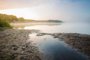 Beautiful morning foggy lake landscape