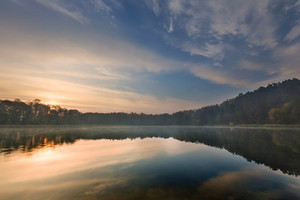 Beautiful sunrise over lake. Tranquil vibrant landscape with polish lake.