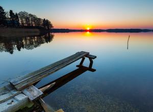 Beautiful lake landscape at sunset. Beautiful polish lake photographed in Mazury lake district.